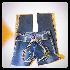 Boho Jeans by Nina Rossi This is an awesome, cool pair of boho/hippie jeans made by Nina Rossi. I absolutely love them, but they are a bit long on me and with the trim, I can't have them altered. They have tan crochet side panels and a great fringed tie belt...perfect, new condition...no rips, stains or tears Jeans