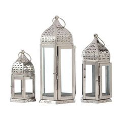 Silver Lanterns in a little cluster under the tv? Sneakily slipping in with the subtle moroccan theme