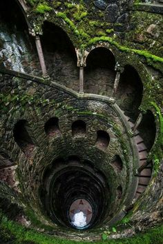 The Initiation Well (Stair Well) is located at Quinta Da Regaleira in Sintra , Portugal. It was designed by Antonio Augusto Carvalho Monteiro and architect Luigi Manini in 1900. It is 27 meters (88.5 feet) deep and the Well acts as a symbol of both demise into , and a rise out of hell.