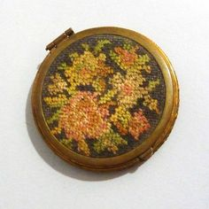 This 1930s Needlepoint Compact is sew pretty! Find it at the Ruby Lane shop Noble Savage Vintage.