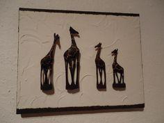 handgeschnitzte Giraffen auf Acryl und Keilrahmen.