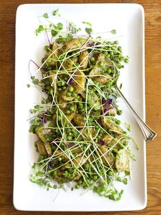 Minted Pea & Potato Salad    10 ounces shelled fresh English peas  1 pound baby potatoes  2 ounces micro greens or baby lettuce mix  2 ounces fresh pea shoots    For the dressing:  2 cups fresh mint leaves*   1 1/2 tablespoons unsalted walnuts  2 fresh lemons  1/3 cup olive oil, plus 1 –2 tablespoons