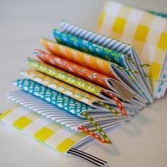 DIY Mini Notebook {Papercraft}    How cute is this simple papercraft DIY mini notebook! This adorable notebook album makes a great addition to a party favor bag, as a gift for a friend, or you can stuff one in your purse to record your important thoughts on the go. The tiny ribbon placeholder is the perfect finishing touch to this one-of-a-kind notebook.