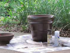 Spray-painted clay pots substitute for pricey glazed pottery.