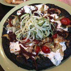 Verdura Pizza - black carbon bread basil pesto mozzarella tomato prosciutto artichoke balsamic red onion Crimini mushroom and zucchini noodles - Mangia.  Perfect!