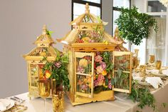Gilded Cage-ON THE BLOG:Our chinoiserie inspired take on Thanksgiving, accented with handcrafted birdcages bursting with flora.