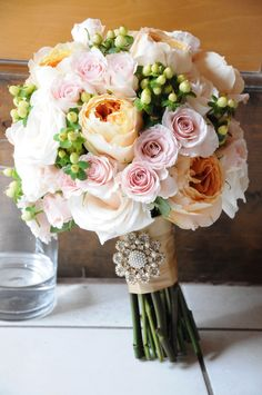 something fluttery or textural in place of the white roses to make it less round, monochromatic of course, and maybe a thin charcoal ribbon?