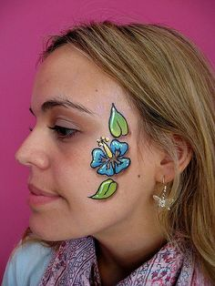 hibiscus surf flower face painting by Lucid Arts Face Painting, via Flickr