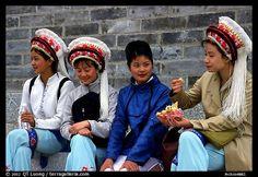 Women wearing traditional Bai dress. Dali, Yunnan, China