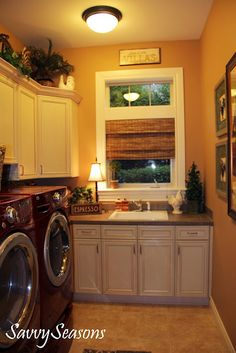 such a pretty laundry room, I LOVE the RED washer and dryer!