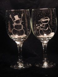 Humorous snow men wine glasses