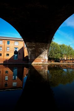 A rail bridge over a canal in Castlefield, Manchester, England, UK. Manchester England, Bridge Design, Salford, Narrowboat, Architecture Portfolio, England Uk, Walkways, Skateboards, Old Town