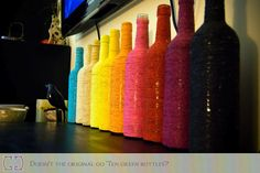 Wrap a bottle with yarn to match your decor. Mix in some scrapbook paper for added interest.