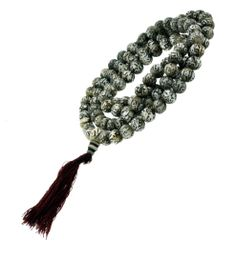 Om Mani Padme Hum Shell Mala, Handmade in Nepal - Mandala Trading  The om mani padme hum mantra is carved into each bead on this mala. The om mani padme hum mantra means hail to the jewel in the lotus and it is Chenrezig's mantra. This mala is 40 inches long. There are 108 beads and each bead is 10 mm wide. The cord is made from cotton and there is a red cotton tassel on the end. This mala was handmade in Nepal.