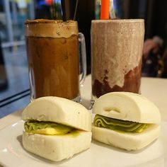 """Did you know mantau translates to """"babarian's head"""".  Steamed mantau with butter & kaya. Milo dinosaur & red bean drinks in the background."""