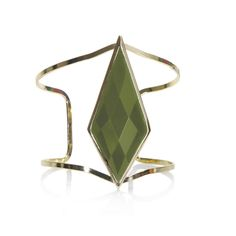 """Adornment for your arm with minimalistic panache. The Aria cuff has a large, faceted dark olive resin stone set on an open gold cuff.  - Goldtone metal, faceted resin  - 2 1/2"""" wide  - Adjustable fit"""