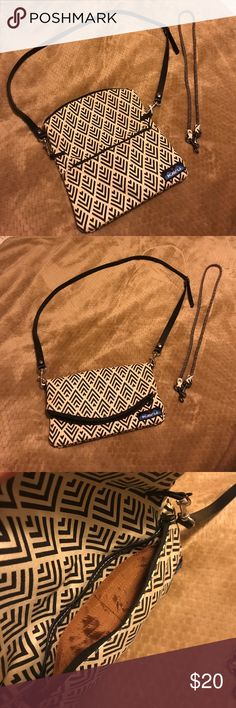 KAVU Fold Over Crossbody KAVU crossbody with 2 straps. One strap is sold black and it adjustable and the other is cream & block but not adjustable. Can be used open for larger items or closed for a smaller look. Two pockets, one includes card slots. Only used once, super clean. No stains, holes or rips. KAVU Bags Crossbody Bags