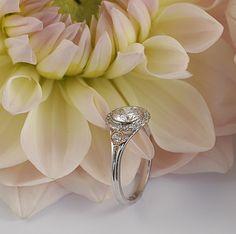 York Jewellers flower halo engagement ring.