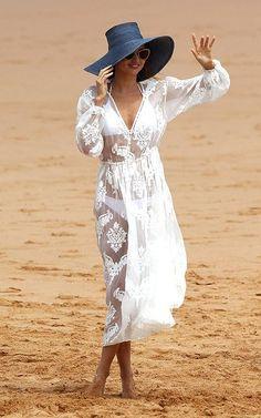 Spotted: Miranda Kerr wears Zimmermann Zoe Chiffon Peasant dress in white.