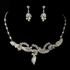 Beautiful and dazzling leaf designed necklace and earring set that features numerous sparkling rhinestones encrusted on design leaves of silver plating and accents of fresh water pearls. This lovely and exquisite necklace and earring set will complement any wedding grown and wedding inspired look or make an excellent accessory set for any formal events.