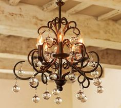 I love the crystal balls hanging from this chandelier.  It is in the running for my dining room.