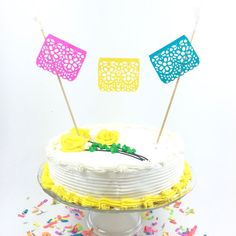 Festive mini papel picado bunting for your fiesta birthday parties, weddings, baby shower, bridal showers and more! This super cute topper is 8 inches tall and 8 inches wide. Can be made larger or smaller to fit your cake. Tons of colors to chose from so I can match your theme! If no color is specified I will send 3 brights. Each mini papel picado flag measures 2.5 inches wide and 2 inches tall and is made of card stock. Tissue paper poms made of premium tissue and come in many colors…