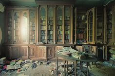 Derelict Manor House in the UK    This photograph shows the private library of a derelict manor house in the UK. The manor has fallen into such a state of decay that it is no longer economically viable to restore as anything other than a labour of love, and the books and other items herein are slowly rotting away.