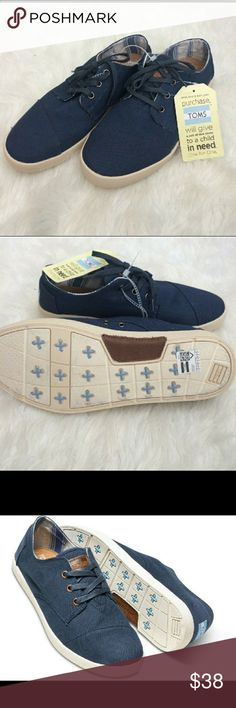 TOMS Paseos Navy Canvas Lace up Shoes NWT TOMS. (No box but tags attached) Navy blue canvas shoes. Perfect with shorts or jeans! Leather accents TOMS Shoes Sneakers