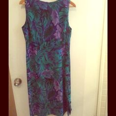 Blue ,purple green floral dress Has black decorative buttons on one side and zips in the back very vibrant color. RK Dresses