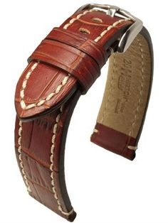 """Hirsch Knight: Powerful men's strap made from precious calf skin with perfect alligator grain effect – and with that variation of dark and light shades that is normally only found in genuine alligator hide. Knight combines modern design and the time-honoured """"belt look"""" that is underlined by the elaborate finish of the edges which is applied by hand three times. Pleasantly soft and supple on the skin thanks to waterresistant HIRSCH Oysterglove Supersoft lining leather."""