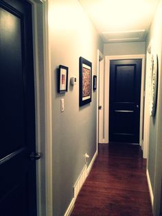 Could so do this in our hallway, same layout!!! Im in love!! Black interior doors, black and grey interior, hallway decor