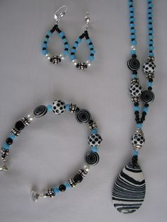 Cute beaded set of earrings, bracelet, and necklace.