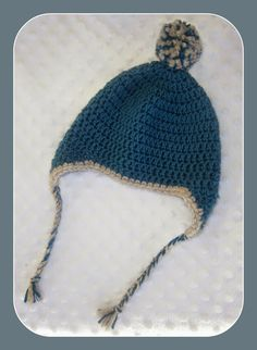 Pom Pom Earflap Hat. My resource for hats is always Sarah of Repeat Crafter Me