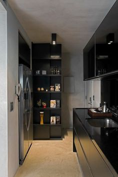 Contemporary Loft Finds The Perfect Balance Between Cool And Elegant Black is the main color chosen for the kitchen cabinets. The cement gray background and stainless steel appliances are the perfect elements to make this dark shade rock in a chic way.