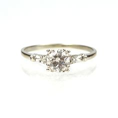 sz 5.5 please... love that the diamond isn't sticking up out of the ring. Antique engagement rings are ALWAYS BETTER
