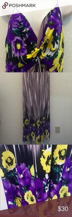 BEAUTIFUL PURPLE & YELLOW PLUS SIZE MAXI DRESS GORGEOUS LONG PLUS SIZE MAXI DRESS IN A STUNNING COMBO  OF YELLOW FLORAL SPAGHETTI STRAP AND ELASTIC FITTED UPPER BODICE WITH A DEEP V & VERTICAL PURPLE STRIPES PROVIDE A FLATTERING SLIMMING LOOK WITH SAME FLORAL YELLOW DESIGN ON THE LOWER PORTION. WORN ONCE FOR NIECES WEDDING WITH PURPLE COWBOY BOOTSNO LONGER FITS. Bust-38 C-D side 14 Looks stunning on perfect summer wedding or casual look maxi dress versatile fit withe strap and bodice design…