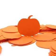 Orange pumpkin paper punches for Halloween, autumn, fall