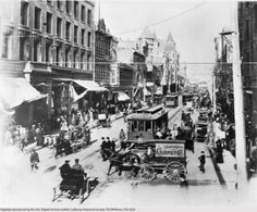 View, looking north from Third St., of a busy Spring St. in downtown Los Angeles circa 1905.