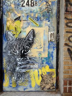 C215 - Kitty Love. cat street art by Christian Guémy, A.K.A. C215. photo by i_follow on  Flickr.