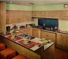 Wood Cabinets, probably similar to the original ones in the Wayland house.1950s Kitchen Designs - Kitchens by Riland