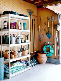 I really like at least one wall in a garage covered in this so you can hang things easily.  -- Cover unfinished walls with four-by-eight-foot sheets of quarter-inch pegboard ($10 to $15 at home centers) so you can hang tools. If walls are finished with Sheetrock, mount tool racks instead.