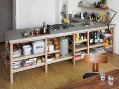 Berlin-based designer Rainer Spehl has twinned a solid oak frame with a concrete worktop by betonWare to create a kitchen that does exactly what a kitchen should do. It has a sink, cooktop, and loads of open storage and preparation space. | iGNANT.de