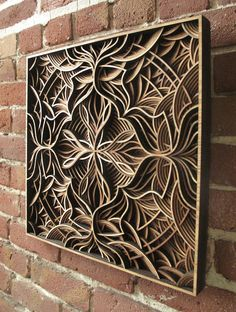 """Wooden """"handcrafted"""" (laser cut) mandala pinned by emancipated squirrel"""