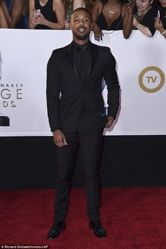 Also on the red carpet was Boseman's movie co-star Michael B. Jordan who chose an all-black outfit pairing a black shirt and bow tie with a tuxedo suit Black Prom Tux, Black Suit Black Shirt, All Black Tuxedo, Black Tuxedo Wedding, Black Outfit Men, Men In Black, Black Suits, Black Prom Suits For Men, Prom Tuxedo