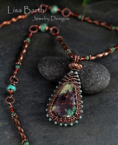 This one turned out very exotic looking.  The stone is natural copper so naturally, I wrapped it in copper.  There are turquoise accents to pull the green out.  Hope you like it--Lisa Barth