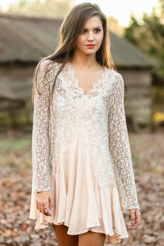 """Get ready to be caught up and """"Lovely In Love"""" with this piece! Simply soft and highlighting everything that you love about yourself, this is a sure shot that you will not want to go without! Sheer lace dress with a V-neckline and long sleeves. Unlined. 1: 100% Rayon. 2: 100% Polyester. Wash by hand in cold water or dry clean. Lay flat to dry. Do not bleach. Made in China. Model is wearing a small.  *RDB stylists recommend consulting exact measurements below for the best fit*  Length: Small…"""
