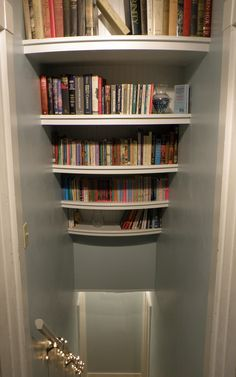 Beautiful, white, curved, bookshelves with bead-board backs that my husband designed and built above our hall stairs. I loved these and filled them! Then we moved. :-/ Still a happy memory though. :-)