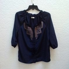 Old Navy Embroidered Blouse with Tassels Old Navy size medium in excellent condition! This top feels so smooth and silky and is perfectly flowy! Details include buttons down the front, ruffles at the neckline, embroidery on the chest, and tassels. The color is a deep navy. Please ask any and all questions before purchasing. Thanks! Old Navy Tops Blouses