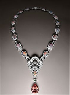 Louis Vuitton Necklace in white gold and platinum, a 37.07 carat Imperial topaz, a 1.10 carat demantoid garnet, opals for 30.95 carats and diamonds for 24.52 carats..