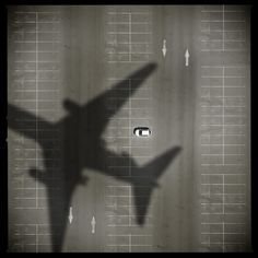 A Car. A Plane. Shadow.